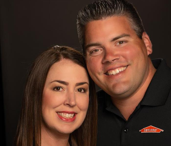 photo of a man and woman in a black shirt with a SERVPRO logo